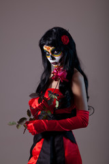 Sugar skull lady with red rose