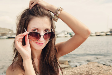 beautiful sexy woman portrait to the nature in black sunglasses