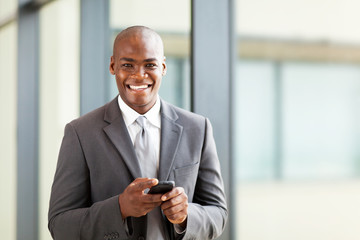 young african business executive with smart phone