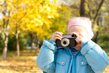 Small girl taking a photograph