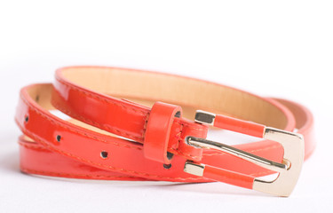 Fashionable colorful belts on white background