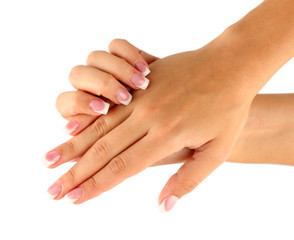 Beautiful woman's hands with french manicure on white