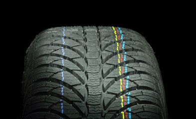 Car tire isolated on a black background