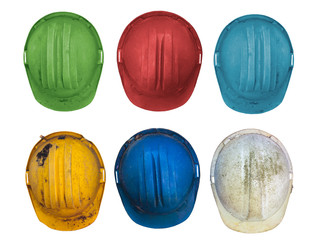 Six old colorful construction helmets