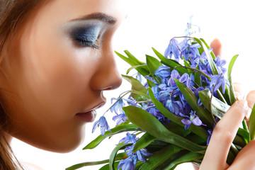 Fototapeta Beautiful teen girl smell and enjoy fragrance of snowdrop flower
