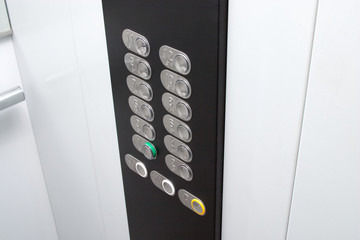 Elevator black control panel with silver metal buttons