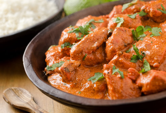 Creamy butter chicken curry with basmati rice.