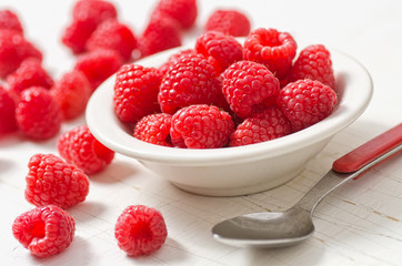 A small bowl of freshly picked raspberries.