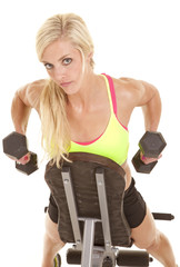 woman looking on bench weights