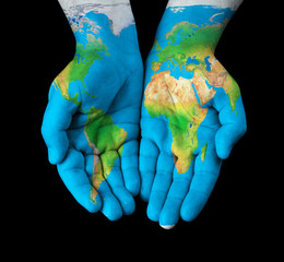 Wall Murals Northern Europe Map painted on hands showing concept - the world in our hands