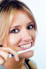 beautiful blonde woman picking his teeth