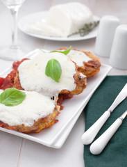 Pork or veal parmigiana in bread crumbs