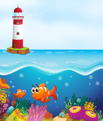 a light house, fishes and coral in sea