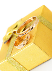 Gold wedding rings on the box