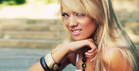 Portrait of a blond woman, close-up outside shot