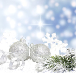 Christmas branch of tree ribbon bauble snow on blue background