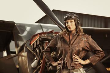 Beautiful woman pilot: vintage photo Fototapete