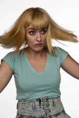 Blonde woman on white blown back