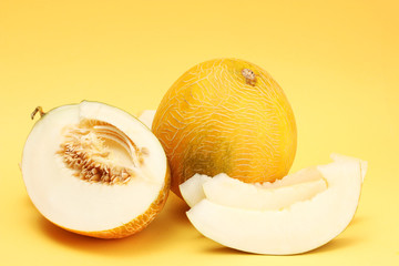 ripe sweet melons, on yellow background