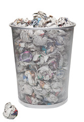 Wastepaper basket with papers lying over white background