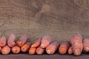 Fresh winter carrots in a wooden box
