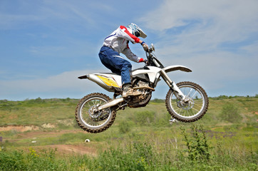 Motocross rider on a motorcycle in the air