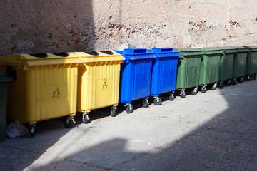 plastic big trash recycling bins on the street