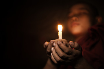 Novice with candlelight