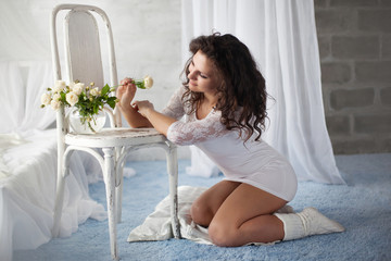 beautiful young woman in a white interior