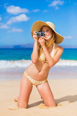 Beautiful Woman at the Beach with Camera