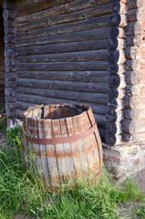 old aged wooden barrel near barn