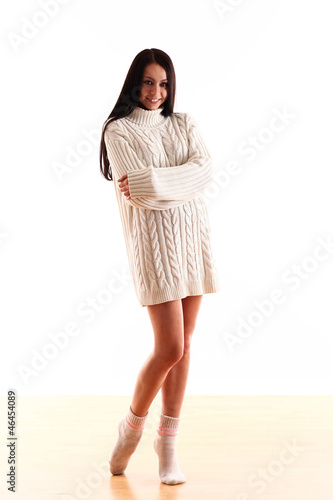 portrait of young and attractive girl in winter sweater and nake