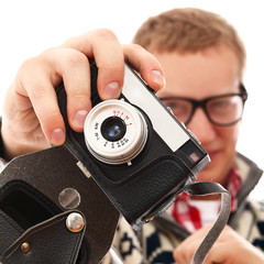 Young photographer with old camera make a photo shoot of you