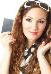 Close-up portrait of young shopping woman holding credit card