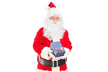 A happy santa claus with a giftbox in his hands