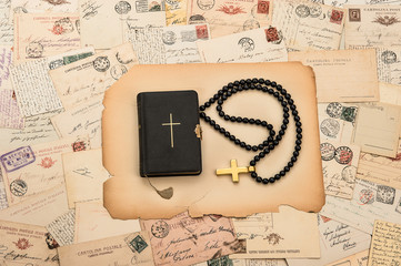 holy bible, rosary, cross and old italian postcards