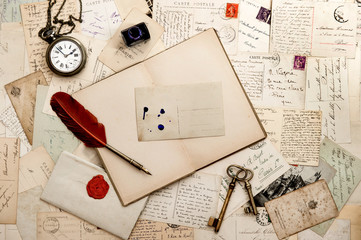 open book, old keys, clock and postcards