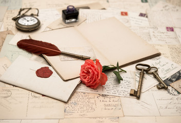 open book, old accessories and postcards