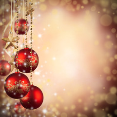 Christmas theme with red glass balls and free space for text