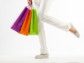 Girl holding multicolored shopping paper bags