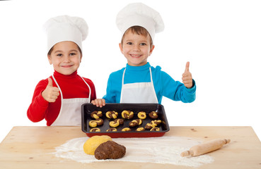 Two kids with baking and ok sign