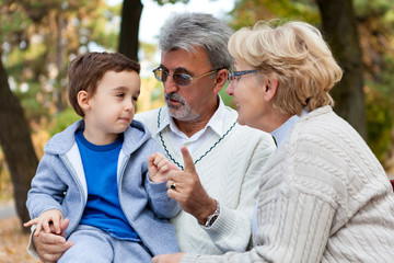 Grandparents and grandson, outdoors