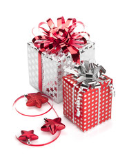 Two red and silver gift boxes with ribbons and christmas decor