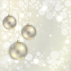 Christmas balls hanging on abstract background