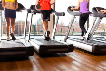 Running on treadmills in a gym
