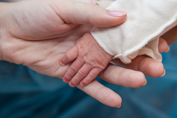 Baby and mothers hands