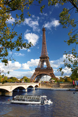 Eiffel Tower  with boat on Siene in  Paris, France