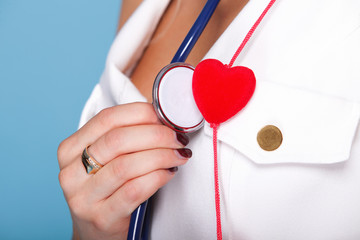 woman in nurse suit with stetoscope red heart
