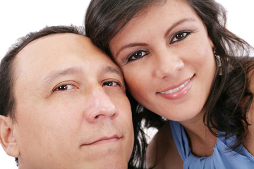 Closeup portrait of a sweet young couple smiling together
