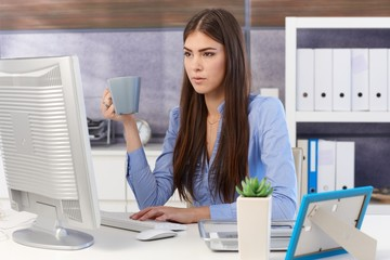 Young businesswoman busy working